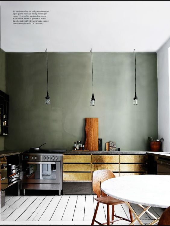 gold kitchen with green walls