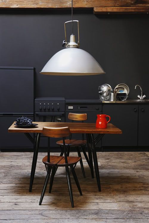 black kitchen with feature furniture