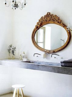 antique mirror feature in modern bathroom