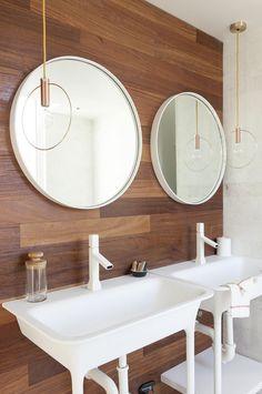 circular mirror in bathroom