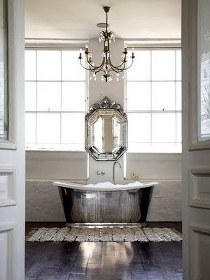 elegant bathroom with ornate mirror