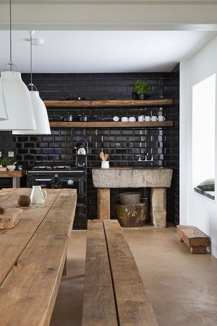rustic simple kitchen with black glass tiles