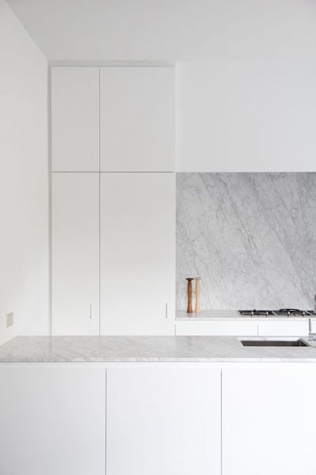 kitchen symmetry, white cabinetry and calacutta marble