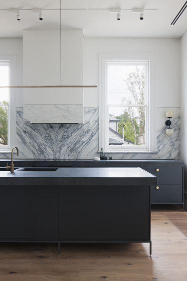 Minimal kitchen design with marble splash back