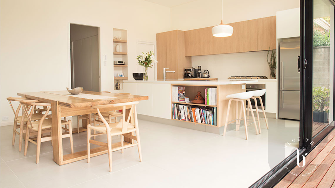 Scandinavian Kitchen Design in Coogee, Sydney featuring timber and white cabinetry with a Scandinavian dining table and chairs.