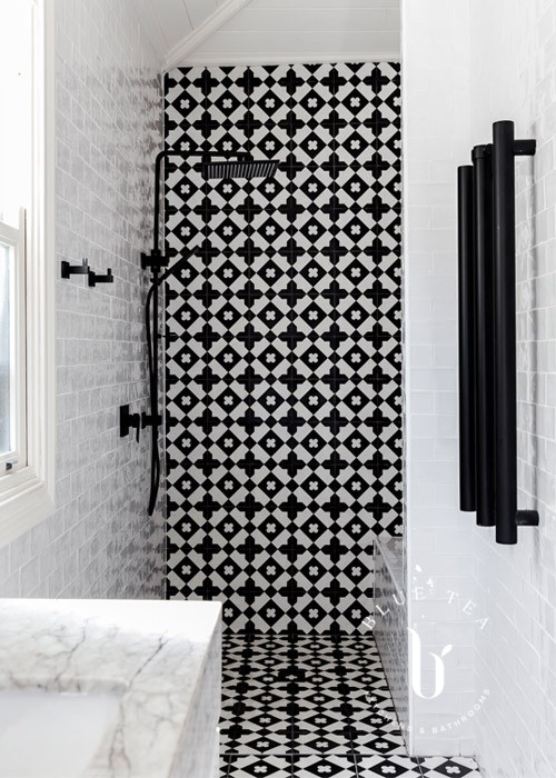 Black and white feature tiles in a walk-in shower Drummoyne.
