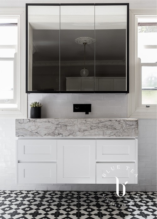 White custom cabinet and thick marble benchtop in this Drummoyne Bathroom