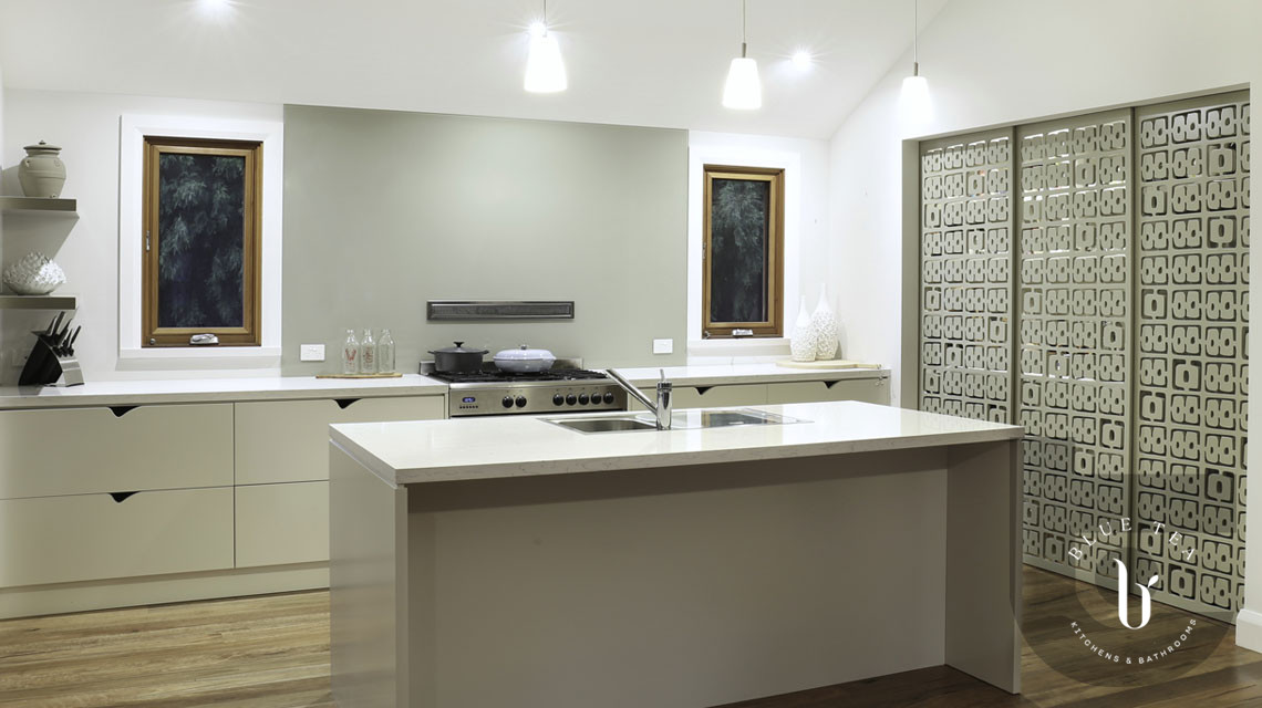 Custom designed sliding doors and kitchen island with no wall cabinetry in Hunters Hill Sydney.