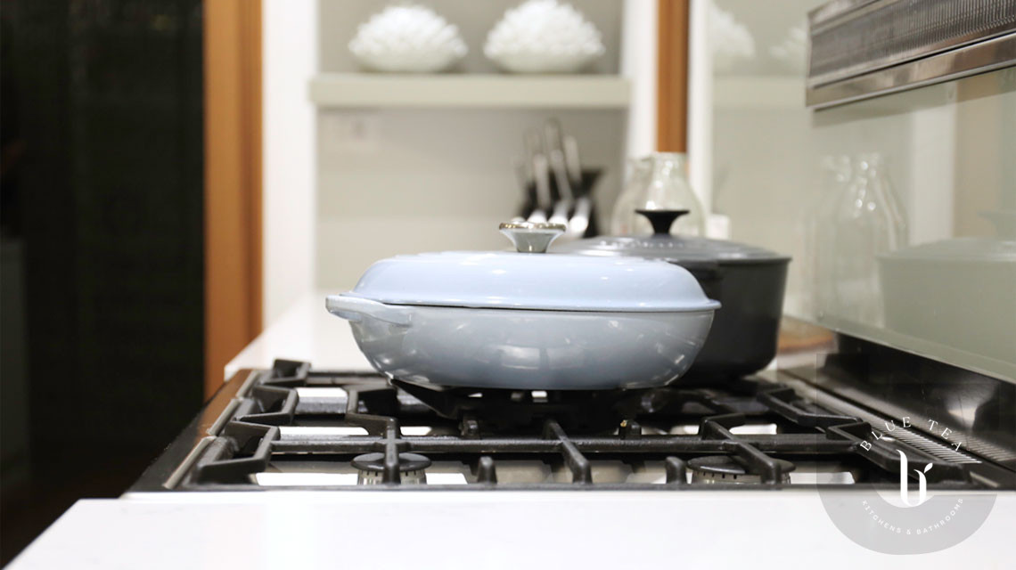 Cooktop details in Hunters hill with open shelves behind.