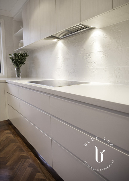 White kitchen drawers with parquetry floors | Blue Tea