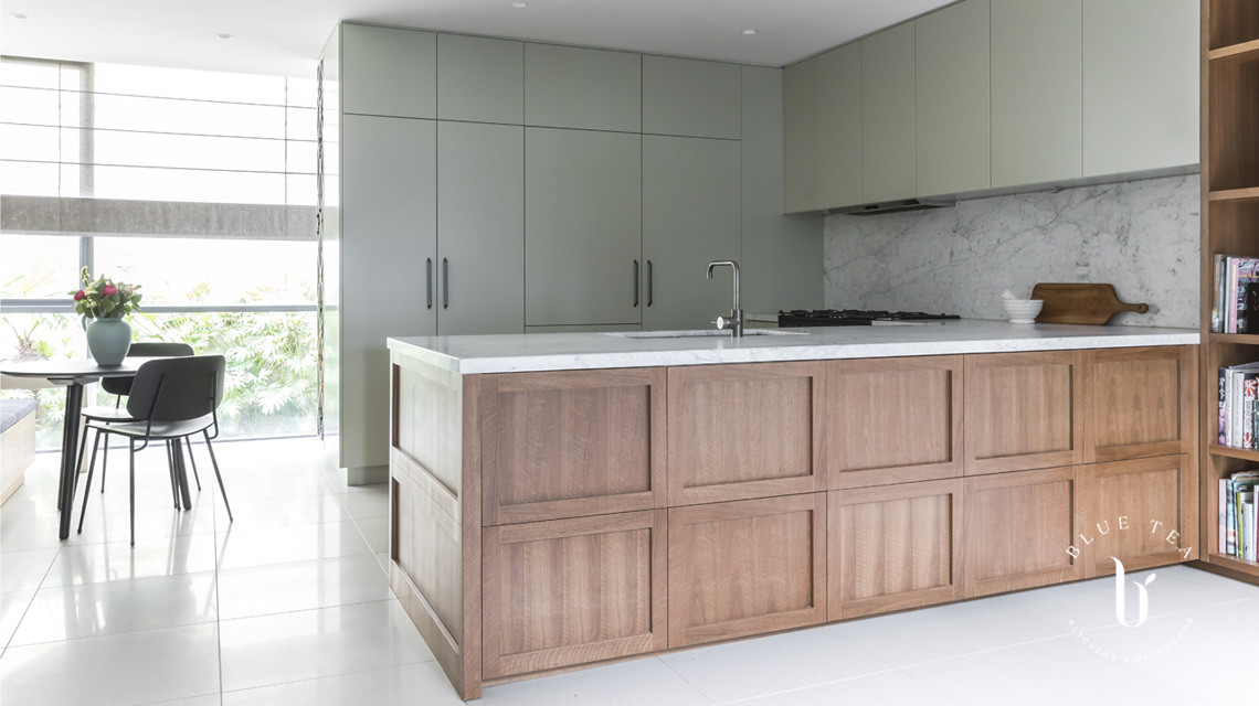 Timber veneer kitchen with green cabinetry | Blue Tea Kitchens
