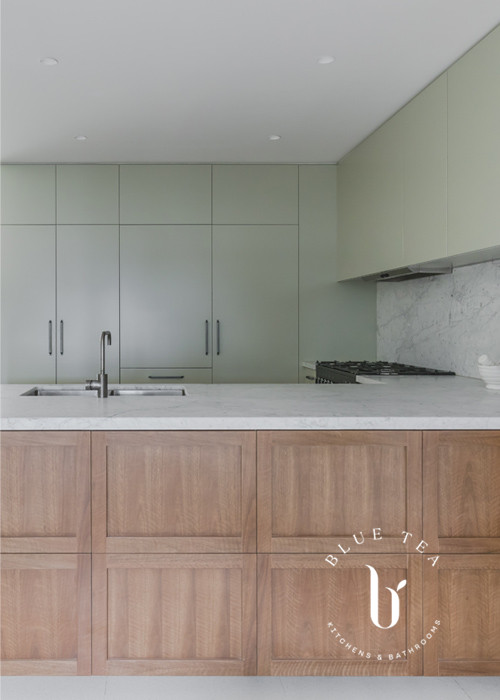 Kitchen with timber veneer feature cabinets and marble| Blue Tea Kitchens