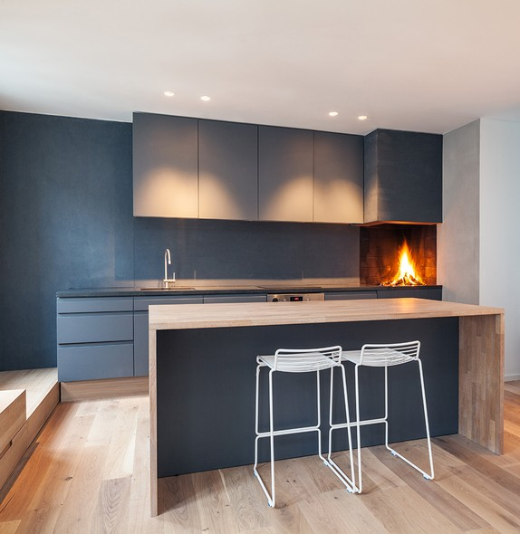 Grey kitchen with fireplace