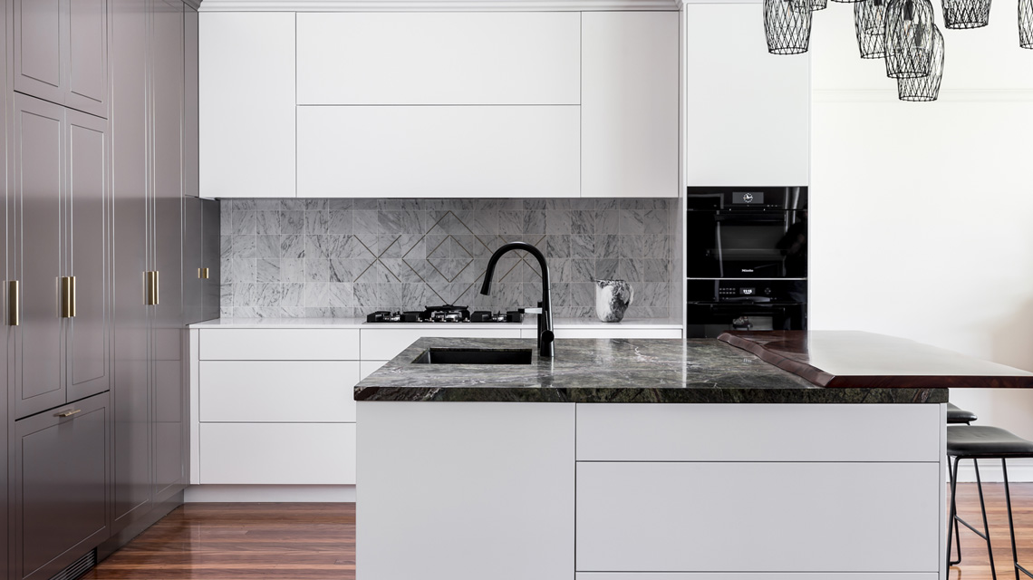 Splashback feature on modern shaker kitchen