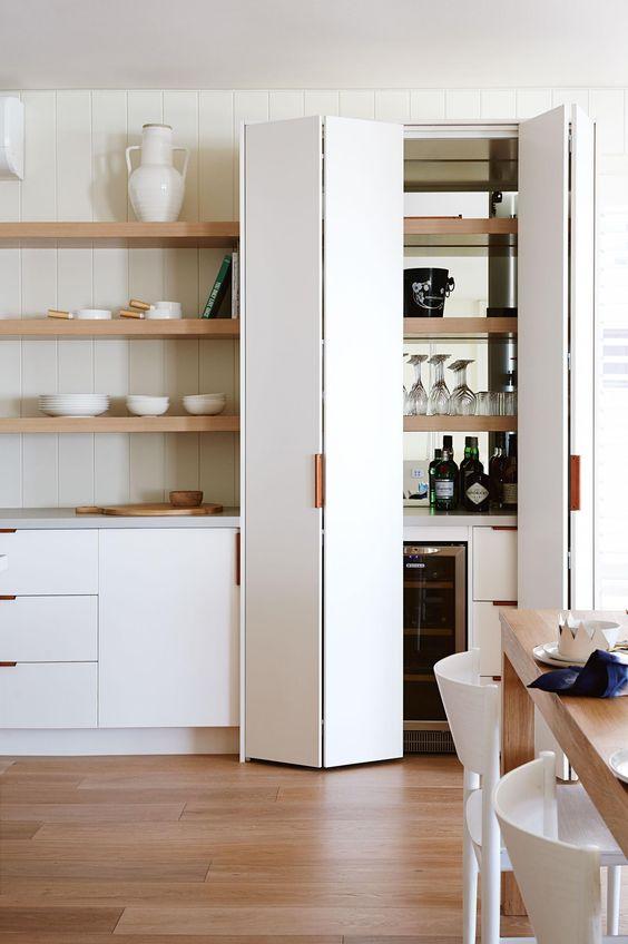 bifold pantry door in white kitchen