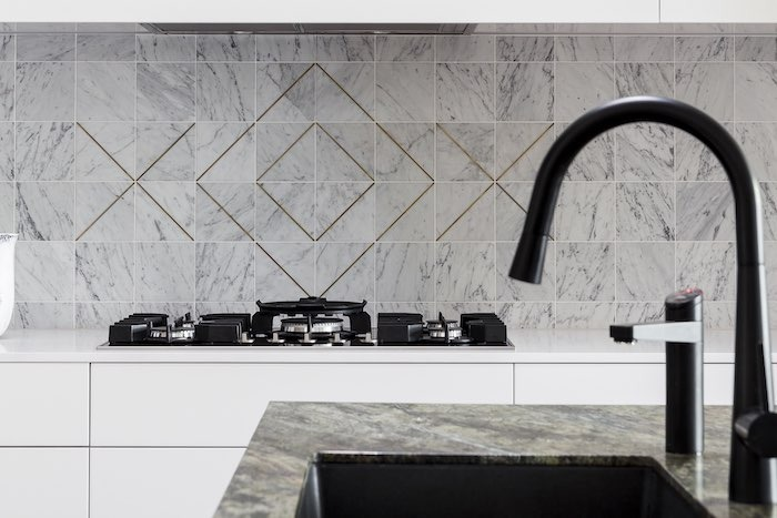 brass and marble splash back for kitchen