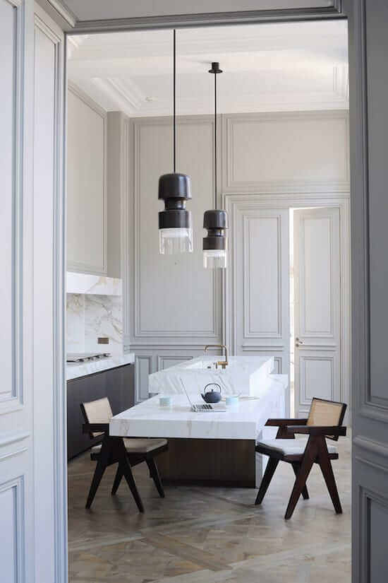 kitchen designed by joseph Dirand featuring thick marble bench tops