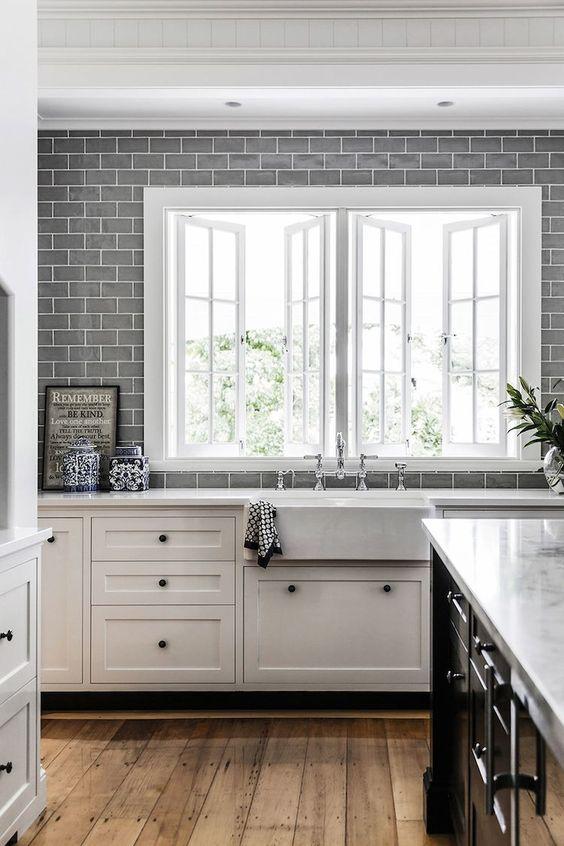 white hamptons kitchen with grey subway splash back