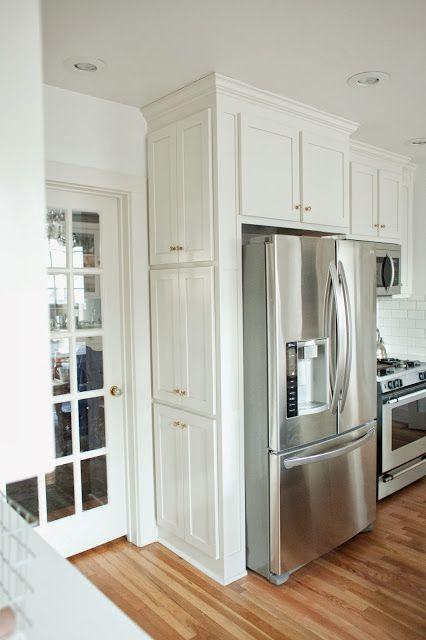 Spice and oil cabinet near fridge