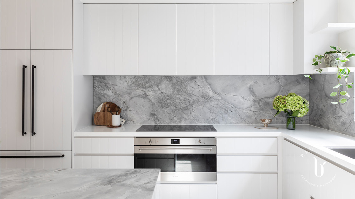 Super white dolomite marble splashback and v-groove feature cabinetry in this Blue Tea Kitchen, Clovelly.