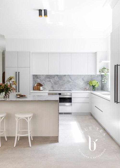 Super white dolomite marble splashback and benchtop with an island in this Blue Tea Kitchen, Clovelly.