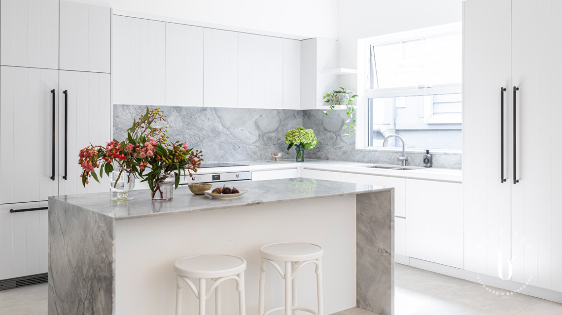Super white dolomite marble island design and white cabinetry in this Blue Tea Kitchen, Clovelly.