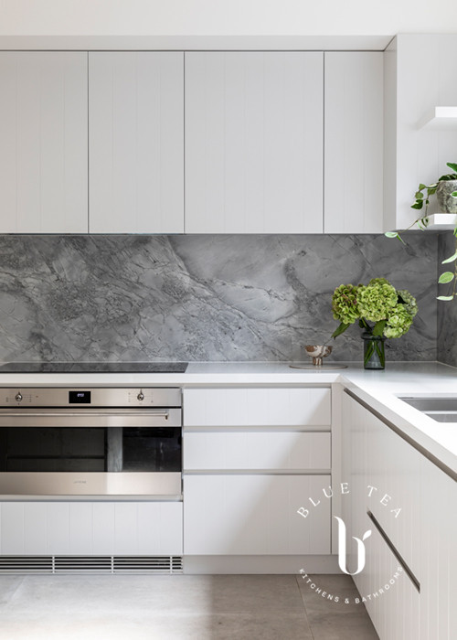 Super white dolomite marble feature splashback in this Blue Tea Kitchen, Clovelly.