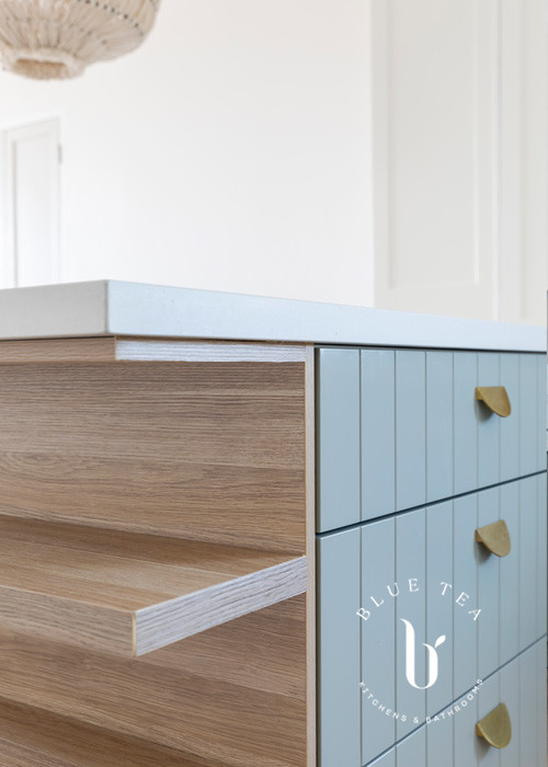 open timber shelf details with soft blue v-groove doors in our North Bondi Kitchen Design