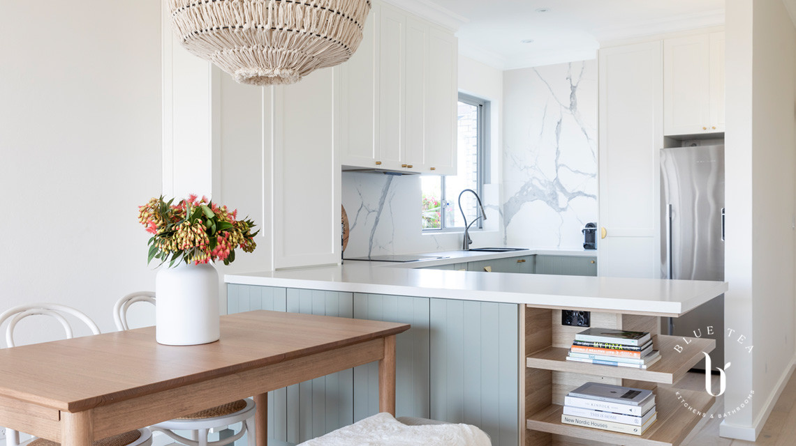 North Bondi kitchen design- V-groove doors soft blue kitchen doors, a marble splashback and feature lighting