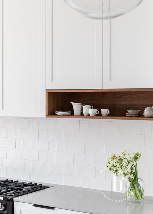Open shelf in solid timber spotted gum and white cabinetry in Petersham, Sydney.