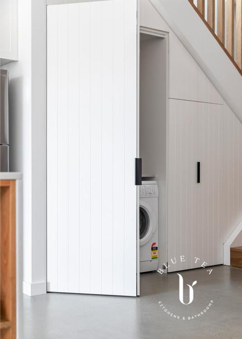 open door understairs showing laundry design, Petersham Sydney.