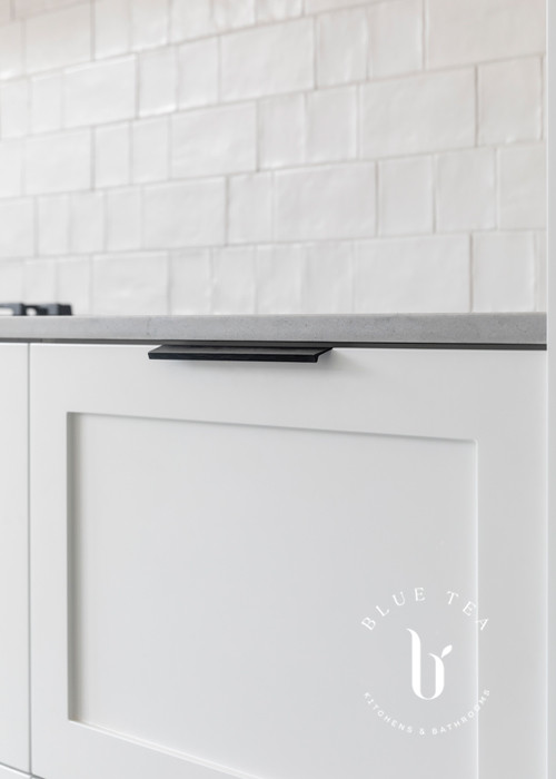 Cabinetry details showing flush black handles, shaker doors and subway tiles in Petersham