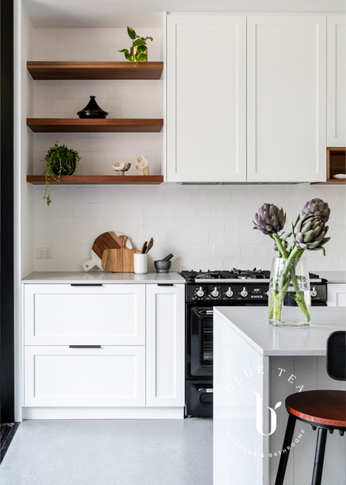 Hamptons Shaker cabinetry and open solid timber shelves in this kitchen at Petersham
