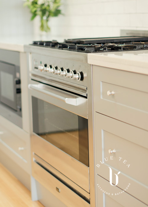 Hamptons Kitchen showcasing a close up of the oven details, with shaker cabinetry and a marble benchtop in Kensington.