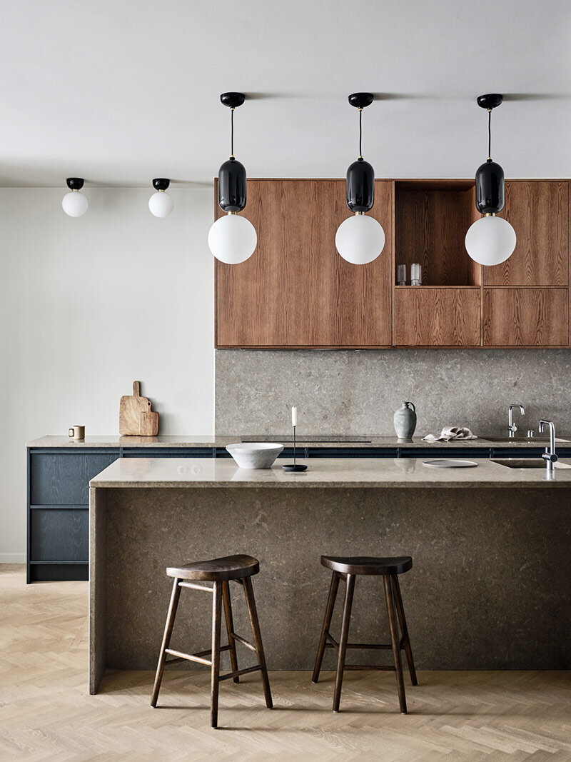 A Stunning two tone timber Sydney kitchen featuring dark and blue stained oak