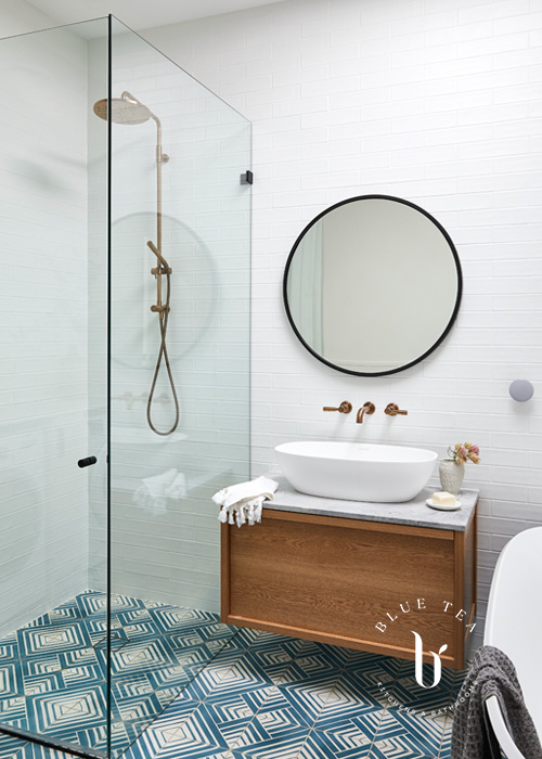 Summer Hill Bathroom Design with geometric tiles and a timber vanity.