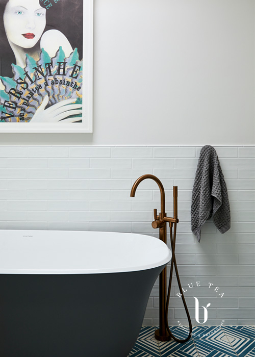Summer Hill Bathroom Design with a black bath and brass tap-ware.