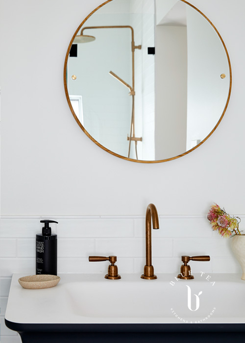 Summer Hill Bathroom Design with a black vanity basin and brass taps.