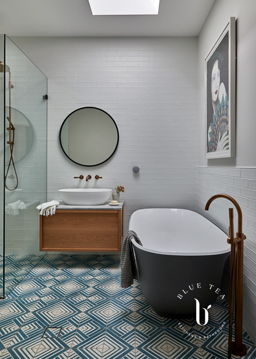 Summer Hill Bathroom Design with geometric tiles and brass features.
