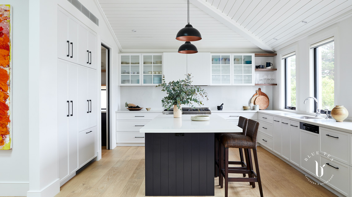 Clovelly kitchen with slimline shaker doors, glass fluted cabinetry and a dark kitchen island with carrara marble