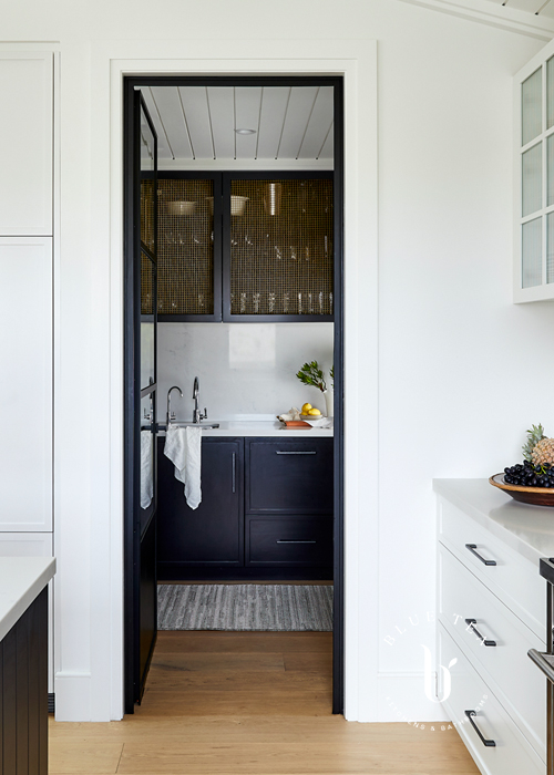 A white kitchen and Black butlers pantry with feature mesh brass Clovelly