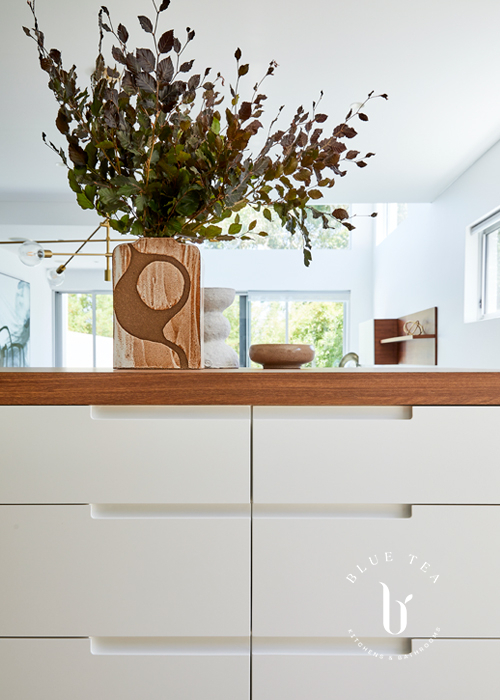Hunters hill white kitchen with custom made handles and a timber benchtop
