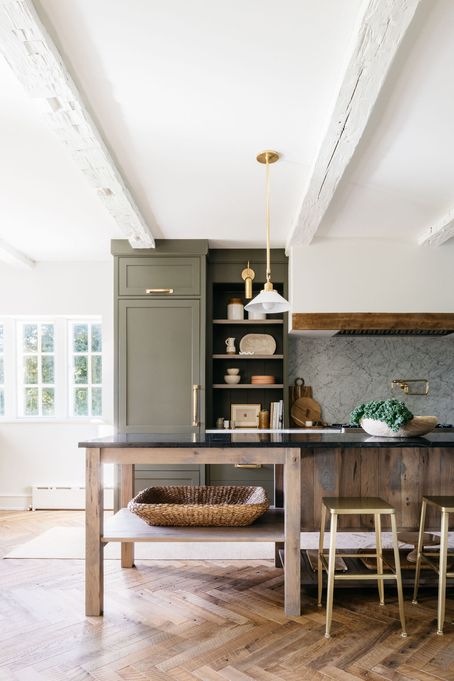 Olive, timber and marble kitchen.